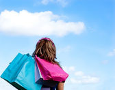 Caucasian woman holding shopping bags outdoor — Stock Photo