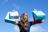 Young woman holding shopping bags outdoor — Stock Photo