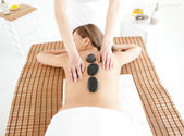 Attractive woman lying on a massage table — Stock Photo