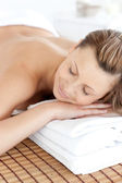Close-up of a caucasian woman having a massage with stones — Stock Photo