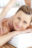 Cheerful woman enjoying a back massage — Stock Photo