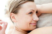 Close-up of a jolly woman in acupuncture therapy — Stock Photo