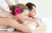 Relaxed young couple receiving a back massage — Stock Photo