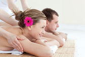 Jolly young couple receiving a back massage — Stock Photo