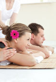 Smiling young couple enjoying a Spa treatment — Stock Photo