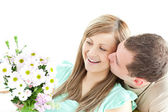 Enamored man giving a bouquet to his girlfriend — Stock Photo