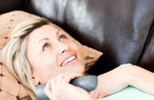 Lively woman using a remote — Stock Photo