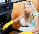 Portrait of a radiant housewife cleaning — Stock Photo
