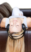 Radiant woman using headphones — Stock Photo