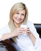 Lively woman holding a cup of coffee — Stock Photo