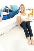 Smiling couple having free time in the living-room — Stock Photo