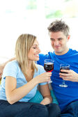 Adorable couple drinking wine together in the living-room — Stock Photo