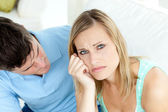Sad couple having an argue in the living-room — Stock Photo