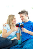 Beautiful couple drinking wine together in the living-room — Stock Photo