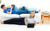 Happy couple having fun together in the living-room — Stock Photo
