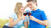 Charming couple drinking wine together — Stock Photo
