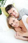 Beautiful lovers having fun together on a sofa — Stock Photo