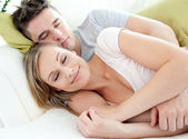 Relaxed lovers having fun together on a sofa — Stock Photo