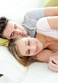 Sleeping lovers having fun together on a sofa — Stock Photo