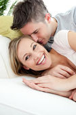 Happy lovers having fun together on a sofa — Stock Photo