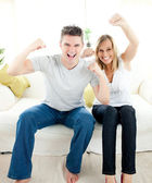Charming couple punching the air — Stock Photo