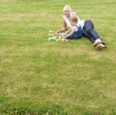 Family lying in the grass — Stock Photo