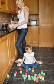 Smiling mother playing child — Stock Photo