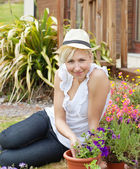 Portrait of a smiling woman with a hat — Stock Photo