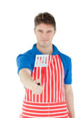 A smiling young man holding a cookware — Stock Photo