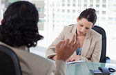 Smiling manager interviewing a male applicant — Stock Photo