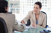 Manager shaking the hand of a male applicant — Stock Photo
