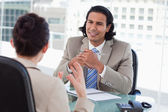 Smiling manager interviewing a female applicant — Stock Photo