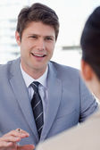 Portrait of a smiling manager interviewing a female applicant — Stock Photo