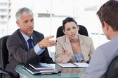 Business team negotiating with a customer — Stock Photo
