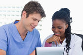 Happy doctors looking at a document — Stock Photo
