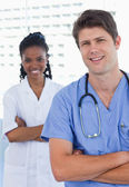 Portrait of happy doctors standing up — Stock Photo