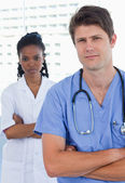 Portrait of professional doctors standing up — Stock Photo