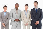 Serious businessteam standing together — Stock Photo