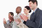 Side view of applauding businessteam standing together — Stock Photo