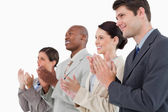 Side view of applauding salesteam standing together — Stock Photo