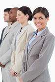 Smiling businesswoman standing next to her associates — Stock Photo