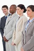 Smiling salesman standing next to his associates — Stock Photo