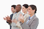 Side view of clapping salesteam standing together — Stock Photo