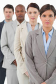 Serious looking businessteam standing together — Stock Photo