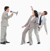 Businessman with megaphone shouting at colleagues — Stock Photo