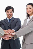 Young businessteam putting hands together — Stock Photo