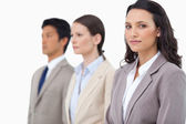 Businesswoman with colleagues next to her — Stock Photo