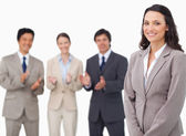Saleswoman getting applause from her colleagues — Stock Photo