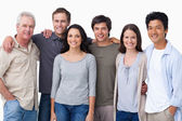 Smiling group of friends standing together — Stock Photo