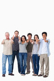 Smiling group giving thumbs up — Stock Photo